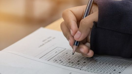 Student filling out multiple choice exam