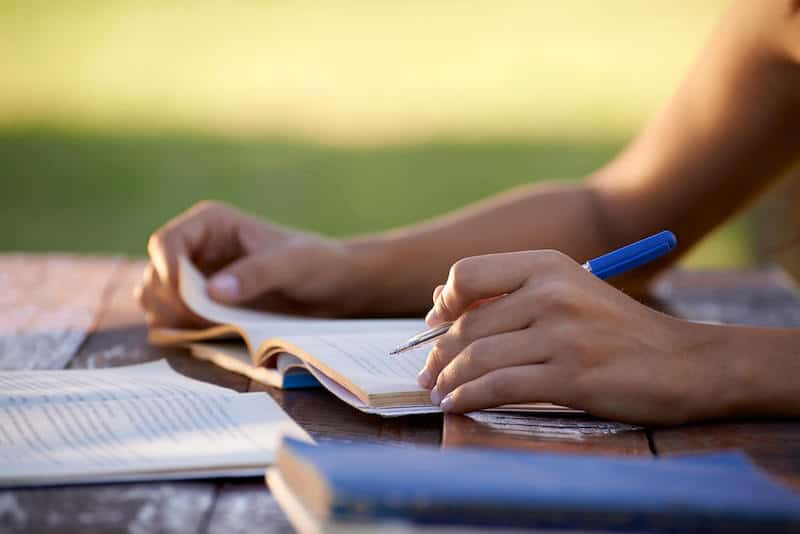 Closeup of Young Woman Studying Outside