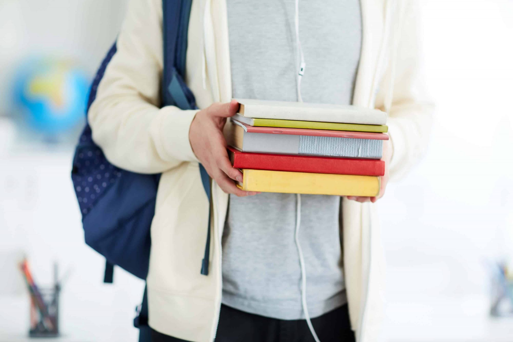 """Student holding books"""
