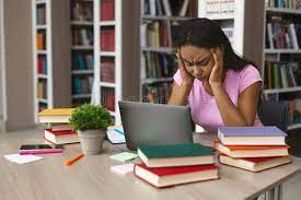 Frustrated student in front of laptop